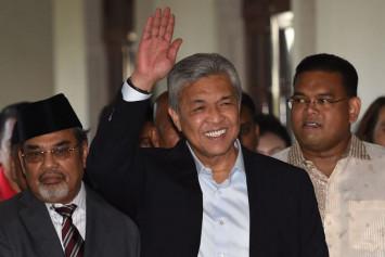Ahmad Zahid Hamidi steps aside as Umno president, hands over duties to deputy