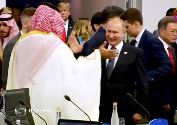 Putin greets Saudi crown prince with high-five at G20 summit