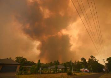 Under pressure Australia PM visits beleaguered firefighters