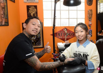 Singapore tattoo artist is a Primary 6 girl