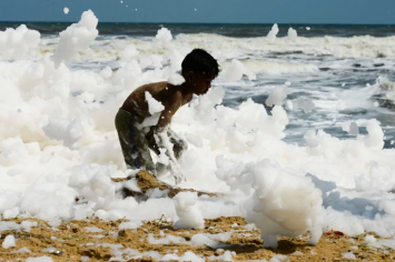 Toxin-laced white foam covers beaches in India after heavy rain