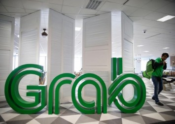 Grab tells staff it's 'in a position to acquire' after Gojek merger report