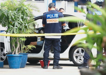 Man drives to police station with alleged lover's body in the car