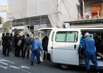 Japan police question US man after finding severed head