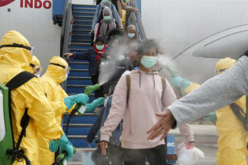 Footage of Indonesian flight passengers from Wuhan getting sprayed with chemicals go viral