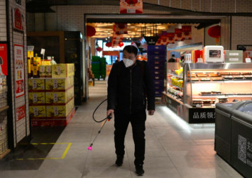 I'm not reckless: China courier braves coronavirus to keep city supplied