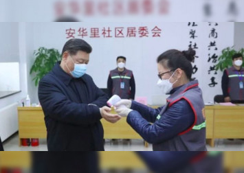 China virus toll passes 1,000 as Xi visits frontline hospital