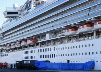 Japan woman with coronavirus dies as cruise ship cases soar