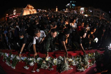 Thai city holds vigil for 30 victims of 'unprecedented' mass shooting