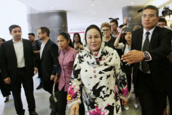 Najib's wife Rosmah says taken ill, her graft trial adjourned to Wednesday