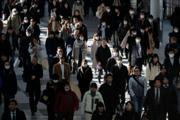 Tokyo commuters bound for Olympic crowd crush as Japan Inc rules out work from home