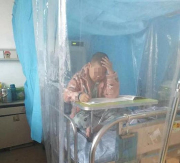 Cancer-stricken boy, 9, takes exam in hospital bed