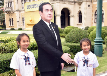 Thai PM defers questions to life-sized standee