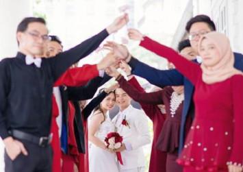 Interracial harmony: A church wedding in Malaysia with Muslim bridesmaids