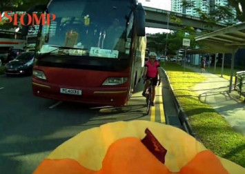 Woman falls off bicycle after bus gets too close to her along Choa Chu Kang Road