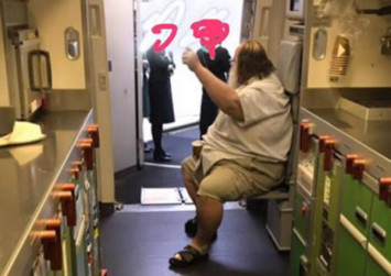 Overweight passenger forces EVA Air flight attendants to wipe his backside