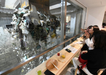 Tipples and trash: A Japan waste plant opens its doors