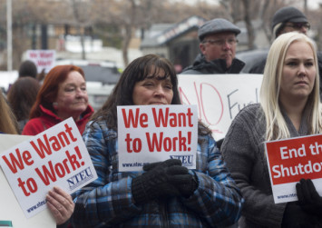 'We want our pay!' furloughed US workers shout at White House as government shutdown continues