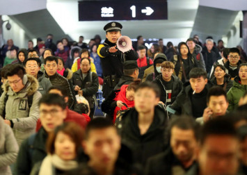 China warns Spring Festival travellers to behave or be banned from rail and air travel