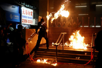 Hong Kong blames protesters for police using force after human rights report