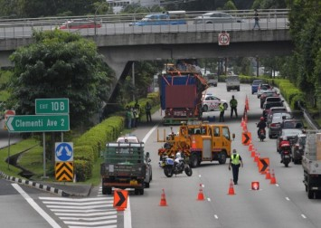 Trailer driver arrested after hitting AYE flyover and causing major traffic jam