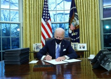 'We must end this uncivil war,' Biden says, taking over a US in crisis