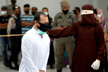 Indonesia's Aceh province publicly canes 2 gay men