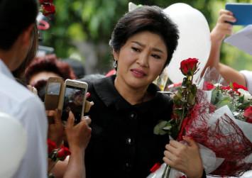 Defiant Yingluck challenges top court