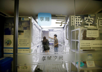 Eyeing sleepy office workers, China's 'sharing economy' opens nap capsules