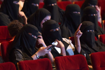 Saudi woman could be jailed for hugging pop star