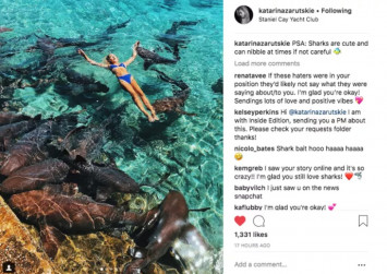 Instagram model gets bitten, dragged underwater while posing with sharks