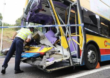 Bus driver dies and 14 injured in crash on Hong Kong motorway