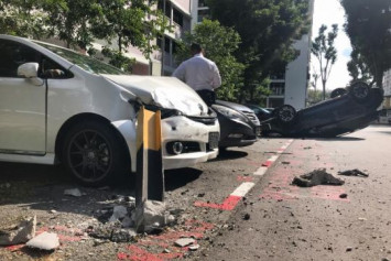 Car turns turtle after 3-vehicle accident in Toa Payoh
