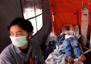 Indonesia reports record Covid-19 deaths as criticism of response grows