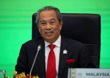 Malaysia's PM faces calls to resign after palace rebuke