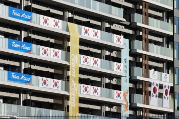 South Korea team told to remove banners at Olympic village