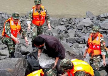Hopes fade in China for 93 missing in landslide