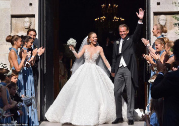 Swarovski heiress can't help but shine in wedding gown studded with 500,000 crystals