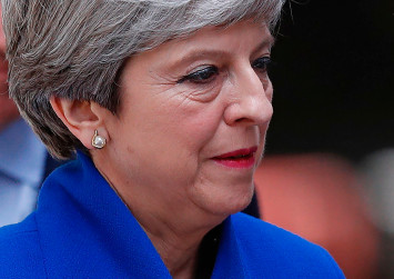 Britain's May apologises to own MPs for election 'mess'