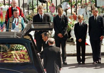 British princes William and Harry re-dedicate grave of mother Princess Diana