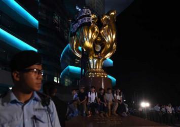 Celebration and protest as China president visits Hong Kong