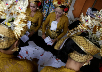 Vote counting starts in Indonesia's regional polls under tight security