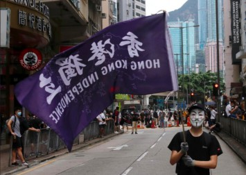 Tensions simmer in Hong Kong as controversial anthem law back up for debate