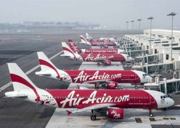 AirAsia in talks to sell 10 per cent stake