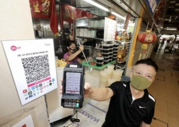 Going cashless pays off in the long run for soya bean hawker