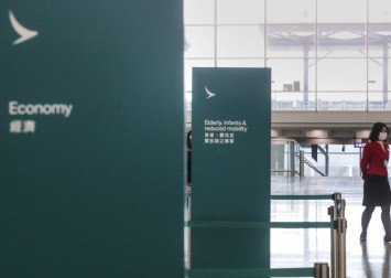 Trading in Cathay Pacific halted on Hong Kong stock exchange as white knight rumours swirl