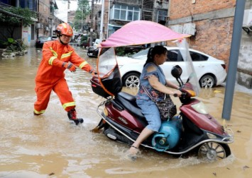 63 dead, missing as floods hit southern China