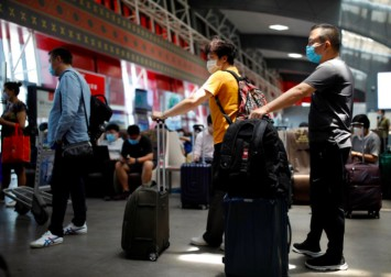 Beijing reimposes travel curbs as it raises emergency response to level 3