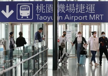 Taiwan to allow transit passengers, some visitors as it starts to ease restrictions