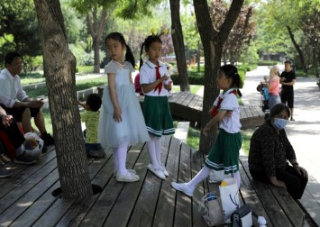 'Too much pressure': Mixed reaction to China's new 3-child policy